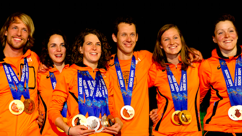 Some of the Dutch speed skate winners pose with their Olympic medals.